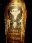 Painted wood featuring an Egyptian goddess in a fashionable dress